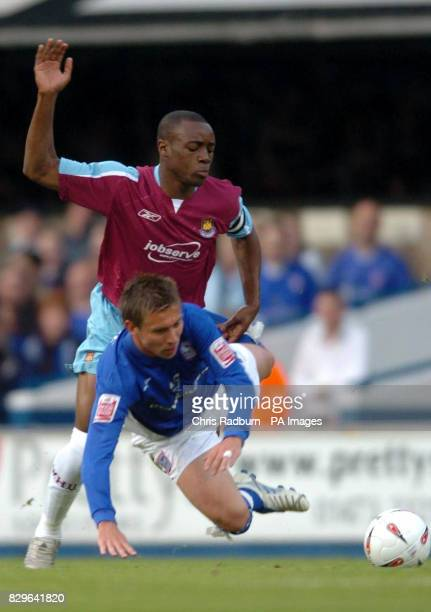Ipswich Town's Darren Currie is challenged by West Ham United's Nigel Rio Coker