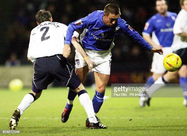 Ipswich Town's Darren Currie is tackled by Preston's Graham Alexander