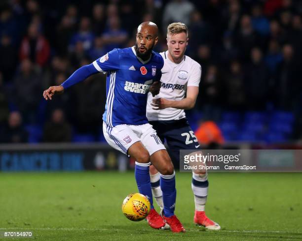 Ipswich Town's David McGoldrick holds off Preston North End's Kevin O'Connor during the Sky Bet Championship match between Ipswich Town and Preston...