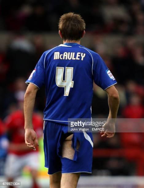 Ipswich Town's Gareth McAuley rips his shorts
