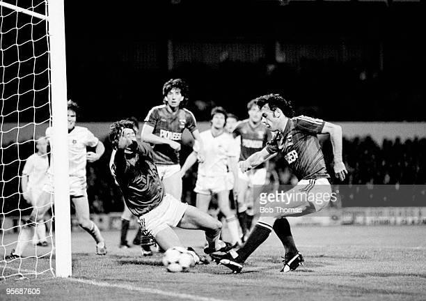 Ipswich Town's John Wark beats Blackburn goalkeeper Terry Gennoe to score his third goal in the Football League Milk Cup 2nd round 1st leg match held...