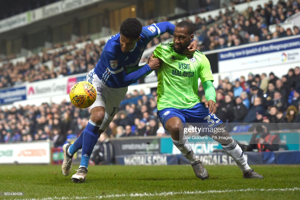 Ipswich Town's Jordan Spence (left) and Cardiff City's Junior Hoilett battle for the ball during the Sky Bet Championship match at Portman Road, Ipswich.