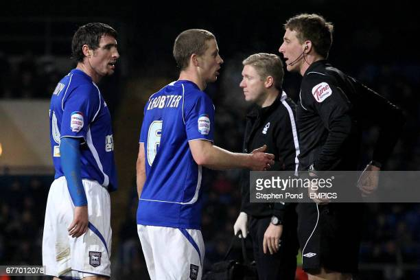 Ipswich Town's Mark Kennedy and Grant Leadbitter argue with referee Darren Sheldrake