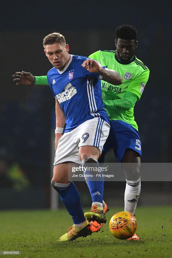 Ipswich Town's Martyn Waghorn (left) and Cardiff City's Bruno Ecuele Manga during the Sky Bet Championship match at Portman Road, Ipswich.