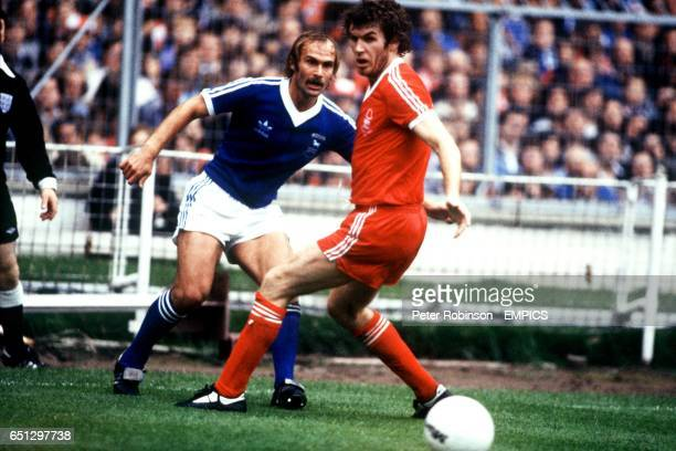 Ipswich Town's Mick Mills looks to get around Nottingham Forest's Peter Withe