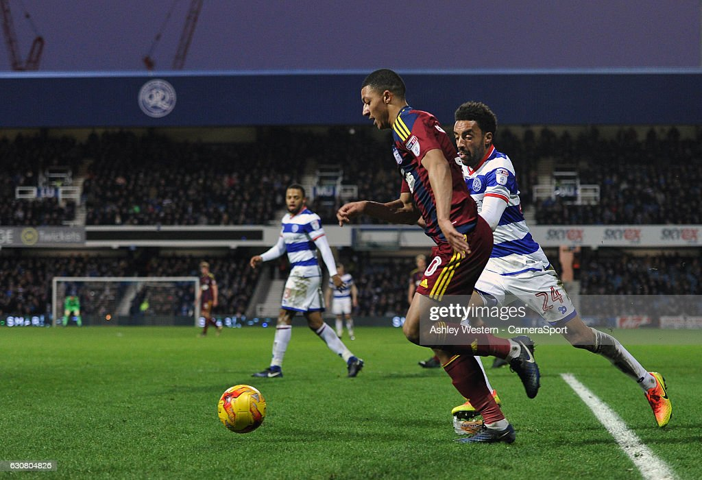 Ipswich Town's Myles Kenlock holds off the challenge from Queens Park Rangers' James Perch during the Sky Bet Championship match between Queens Park Rangers and Ipswich Town at Loftus Road on January 2, 2017 in London, England.