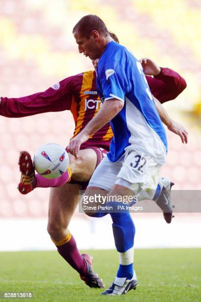 Ipswich Town's Shefki Kuqi comes under pressure from Wayne Jacobs of Bradford City during the Nationwide Division One match at Valley Parade Bradford...