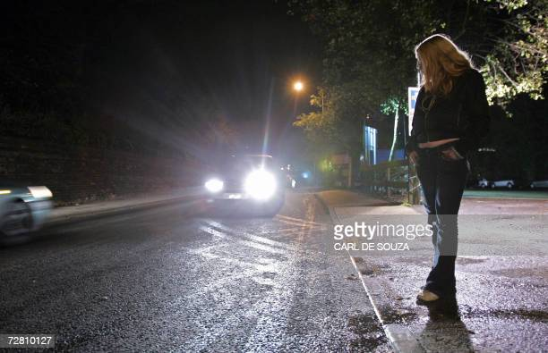 Ipswich, UNITED KINGDOM: A female prostitute known as 'Lou' is pictured on the streets of Ipswich, in Suffolk, in eastern England, 11 December 2006....