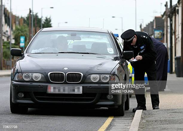 Suffolk Police stop and question the driver of a BMW car on the outskirts of Ipswich in Suffolk in eastern England 14 December 2006 as detectives...