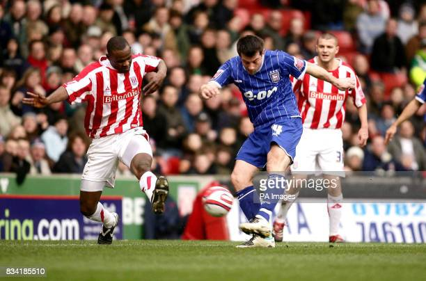 Ipswich's Alan Lee hits a shot over the bar ahead of Stoke's Leon Cort during the CocaCola Championship match at the Britannia Stadium Stoke