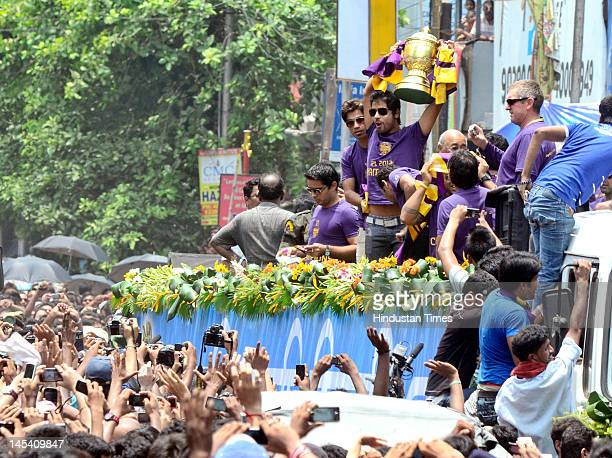 Iqbal Abdulla of Kolkata Knight Riders lifts the trophy during a victory parade on Ashutosh Mukherjee road on May 29 2012 in Kolkata India