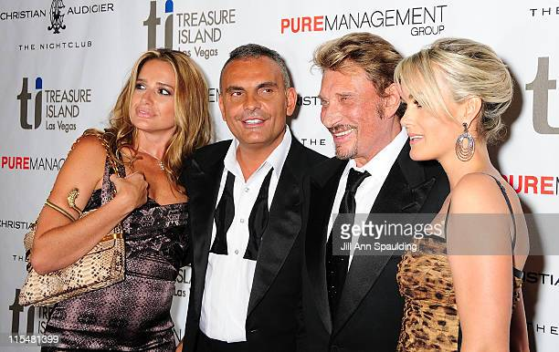 Ira Audigier Designer Christian Audigier Musician Johnny Hallyday and wife Laetitia Hallyday arrive at The Grand Opening of Christian Audigier The...