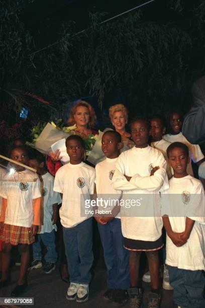 Ira de Furstenberg and Mrs Ouattara with children