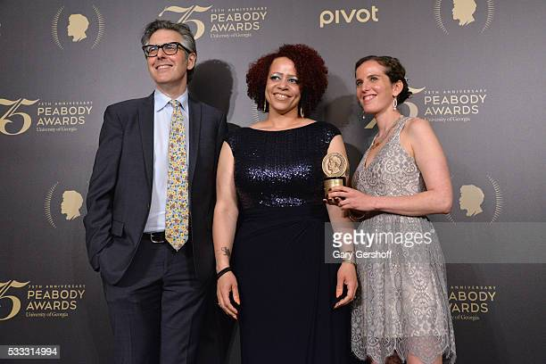Ira Glass Nikole HannahJones and Chana JoffeWalt pose with award during The 75th Annual Peabody Awards Ceremony at Cipriani Wall Street on May 21...
