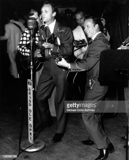Ira Louvin plays mandolin and Charlie Louvin plays acoustic guitar as the country brothers duo The Louvin Brothers performs onstage at the Grand Ole...