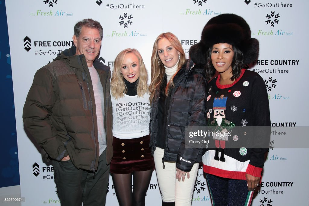 Ira Schwartz, Nastia Liukin, Jody Schwartz, and June Ambrose attend the Free Country and The Fresh Air Fund Partnership Celebration at The Rink at Bryant Park on December 19, 2017 in New York City.