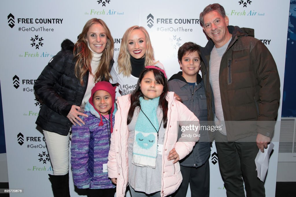 Ira Schwartz, Olympic Medalist Nastia Liukin, and Jody Schwartz attend the Free Country and The Fresh Air Fund Partnership Celebration at The Rink at Bryant Park on December 19, 2017 in New York City.