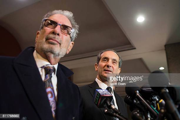 Ira Sherman listens as Joseph Cammarata an attorney for the plaintiffs in the defamation case against comedian Bill Cosby speak to the media outside...