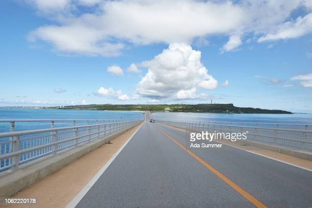 irabu bridge to irabu island okinawa, japan - 湾 ストックフォトと画像