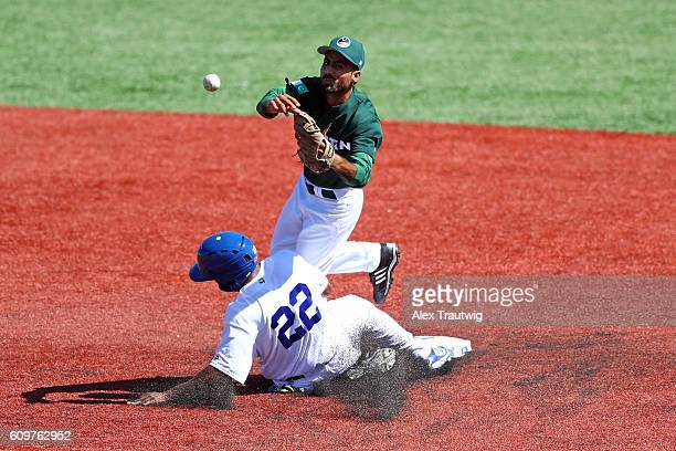 Irait Chirino of Team Brazil slides into second base breaking up a double play as Faquir Hussain of Team Pakistan throws to first base during Game 1...
