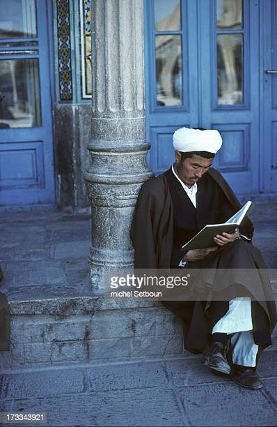 CONTENT] Iran a shia cleric with a white turban read a newspaper in the big mosque of Qom holy city of islam shia