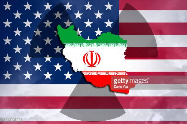 iran american tension concept. the country of iran with the radioactive symbol and american flag behind. - iran stock pictures, royalty-free photos & images