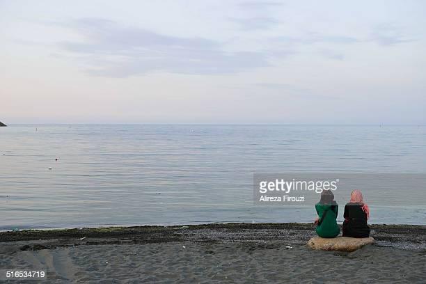 iran, caspian sea - muslim woman beach stock photos and pictures