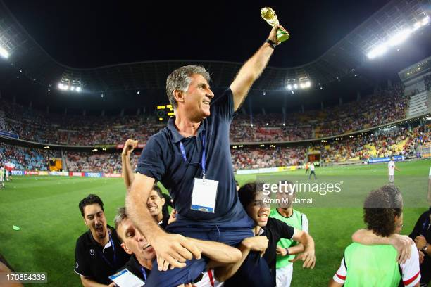 Iran coach Carlos Queiroz celebrates during the FIFA 2014 World Cup Qualifier match between South Korea and Iran at Munsu Cup Stadium on June 18 2013...