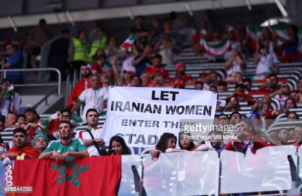 Iran fans hold a sign calling for Iranian women to be let into sports stadiums in Iran during the 2018 FIFA World Cup Russia group B match between...