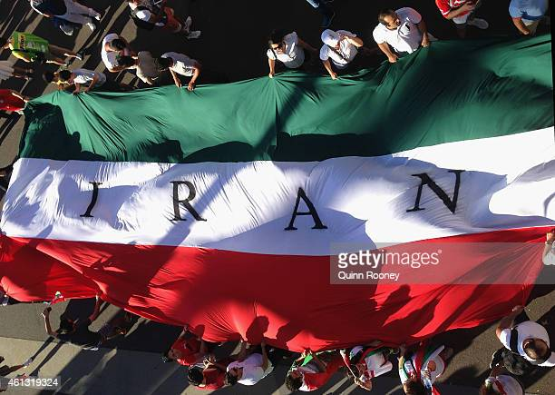 Iran fans hold up a giant flag during the 2015 Asian Cup match between IR Iran and Bahrain at AAMI Park on January 11 2015 in Melbourne Australia