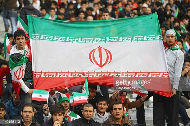 Iran fans show their support during the 2014 FIFA World Cup Group E qualifier match between Iran and Qatar at Azadi Stadium on February 29 2011 in...