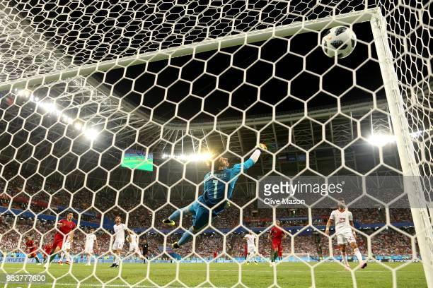 Iran goalkeeper Ali Beiranvand dives in vain as Ricardo Quaresma of Portugal scores his team's first goal during the 2018 FIFA World Cup Russia group...