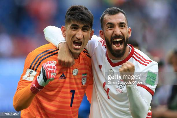 Iran goalkeeper Alireza Beiranvand and Rouzbeh Cheshmi of Iran celebrate victory after the 2018 FIFA World Cup Russia Group B match between Morocco...