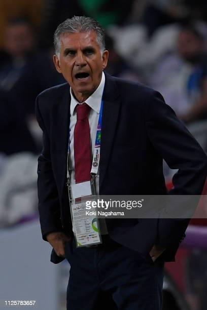 Iran head coach Carlos Quieroz gives advice to Seyed Ashkan Dejagah of Iran during the AFC Asian Cup semi final match between Iran and Japan at Hazza...
