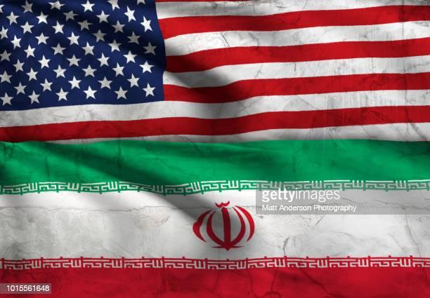 iran - iranian flag usa flag with texture - iranian flag stock photos and pictures