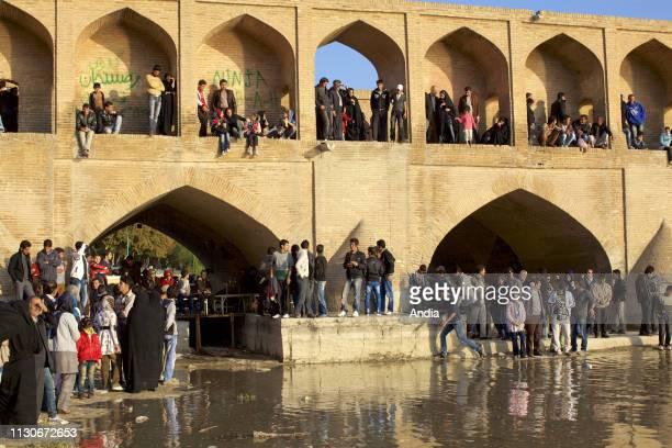 Isfahan . People desperate for water, near the Allahverdi Khan Bridge , across the Zayanderud river.<br><br>.
