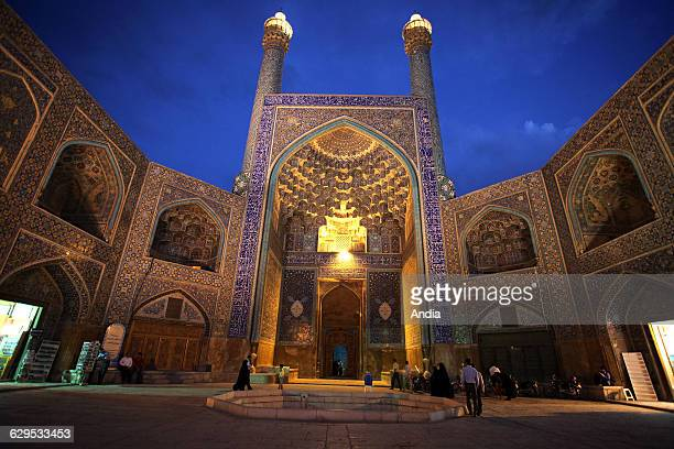 Iran Isfahan The Shah Mosque standing in south side of Naghshi Jahan Square Here at nighfall at prayer time