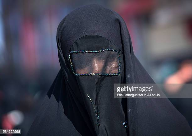 Iran, Lorestan Province, Khorramabad, iranian shiite muslim woman mourning imam hussein on the day of tasua with her face covered by a veil