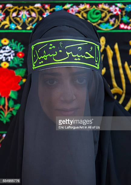 Iran Lorestan Province Khorramabad iranian shiite muslim woman mourning imam hussein on the day of tasua with her face covered by a veil