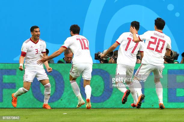 Iran players celebrate their side's first goal an own goal scored by Aziz Bouhaddouz of Morocco during the 2018 FIFA World Cup Russia group B match...