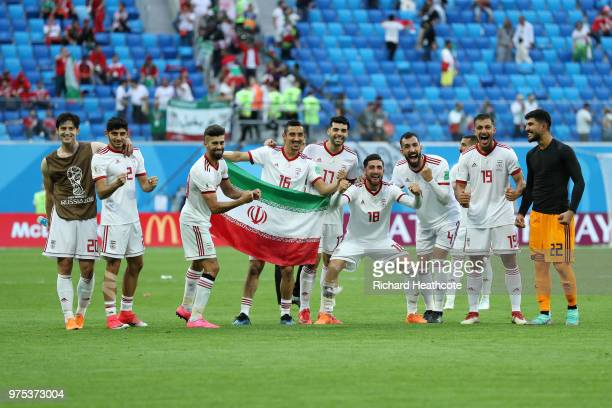 Iran players celebrate their sides victory after the 2018 FIFA World Cup Russia group B match between Morocco and Iran at Saint Petersburg Stadium on...