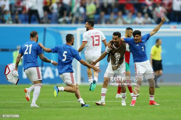 Iran players celebrate their win following the 2018 FIFA World Cup Russia group B match between Morocco and Iran at Saint Petersburg Stadium on June...