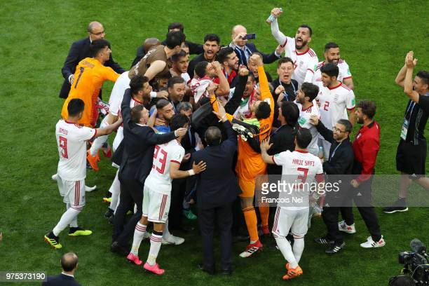 Iran players celebrate victory at the end of the 2018 FIFA World Cup Russia group B match between Morocco and Iran at Saint Petersburg Stadium on...