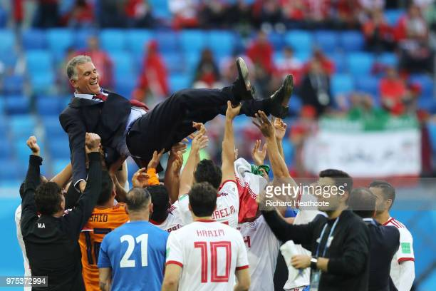 Iran players celebrate victory by throwing head coach Carlos Queiroz in teh air at the end of the 2018 FIFA World Cup Russia group B match between...