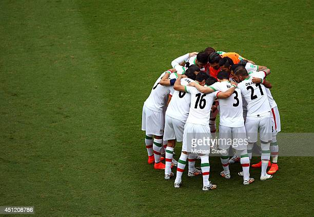 Iran players huddle on the pitch during the 2014 FIFA World Cup Brazil Group F match between Bosnia and Herzegovina and Iran at Arena Fonte Nova on...