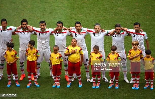 Iran players line up on the field prior to the 2014 FIFA World Cup Brazil Group F match between Bosnia and Herzegovina and Iran at Arena Fonte Nova...