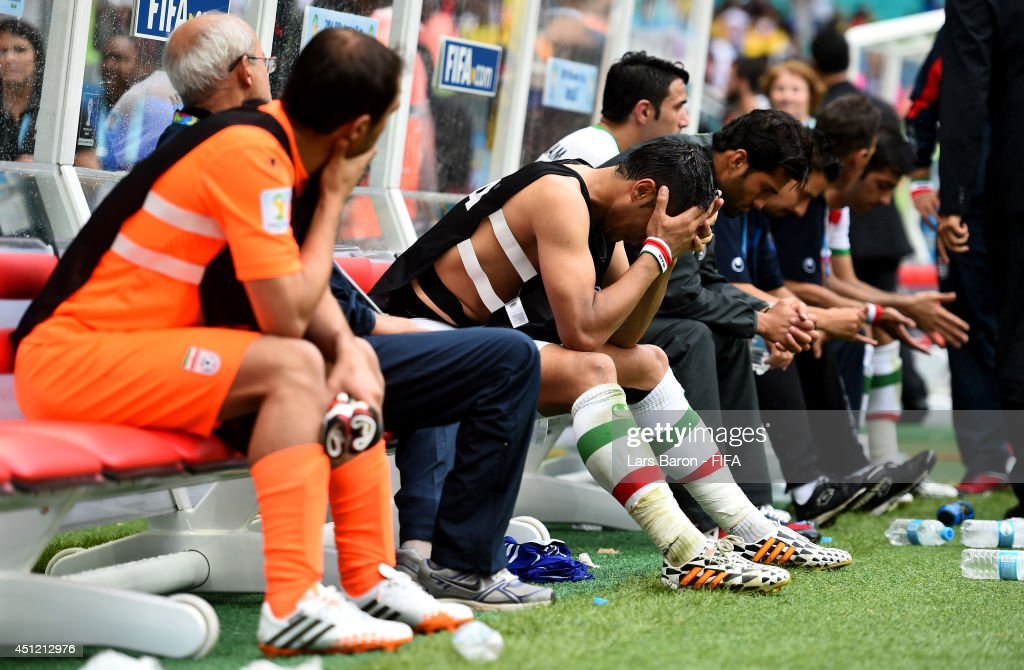 Iran players show their dejection on the bench after the 1-3 defeat in the 2014 FIFA World Cup Brazil Group F match between Bosnia-Herzegovina and Iran at Arena Fonte Nova on June 25, 2014 in Salvador, Brazil.