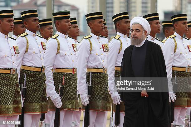 Iran President Hassan Rouhani inspects a guard of honour during the state welcoming ceremony outside the office of Malaysia's Prime Minister Najib...