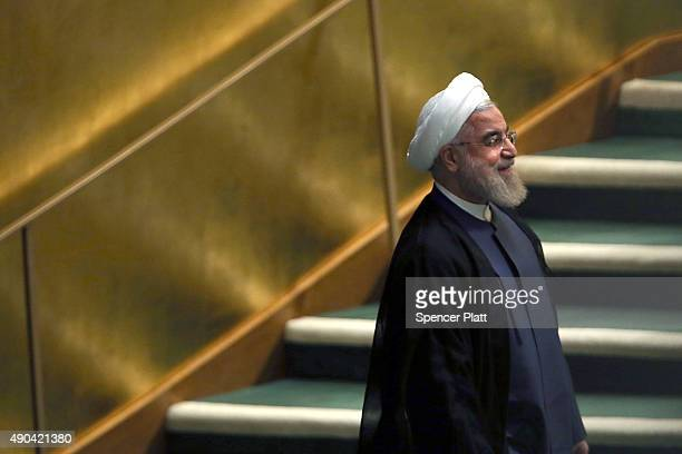 Iran President Hassan Rouhani walks into the hall before addressing he United Nations General Assembly at UN headquarters on September 28 2015 in New...