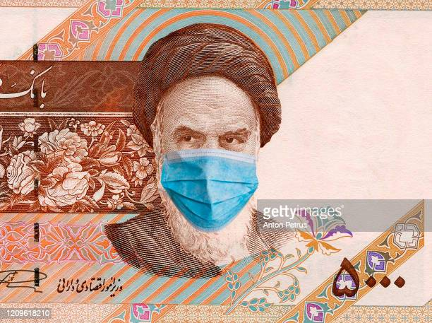 iran quarantine, 5000 rials banknote with medical mask. the concept of epidemic and protection against coronavrius. - iran stock pictures, royalty-free photos & images